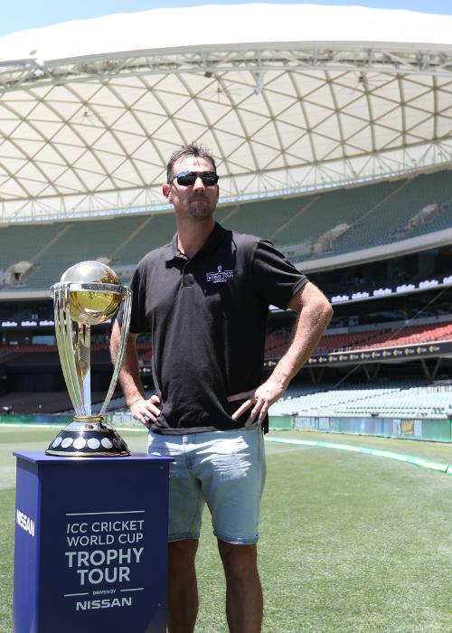 Former Australia fast bowler Shaun Tait poses with the CWC trophy at the Adelaide Oval