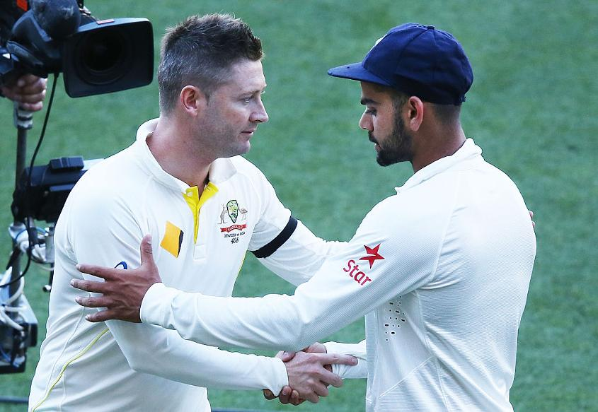 Michael Clarke and Virat Kohli shake hands after day five of the first Test between Australia and India at Adelaide Oval, December 13, 2014