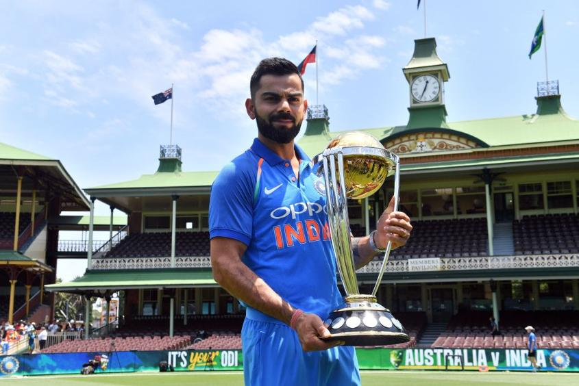 Virat Kohli poses with the ICC Cricket World Cup trophy at the Sydney Cricket Ground in Sydney on January 11, 2019