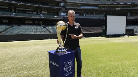 Damien Fleming poses with the CWC Trophy at the MCG