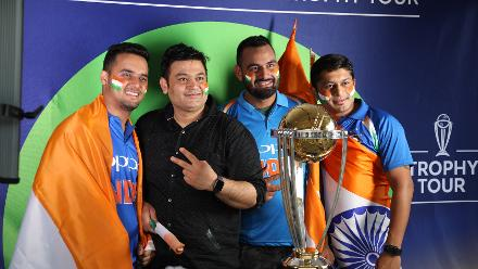 Fans pose with the CWC Trophy