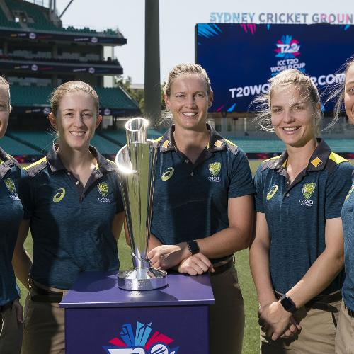 Members of the Australia Women's team pose with the ICC T20 World Cup 2020 trophy during the fixture announcement event