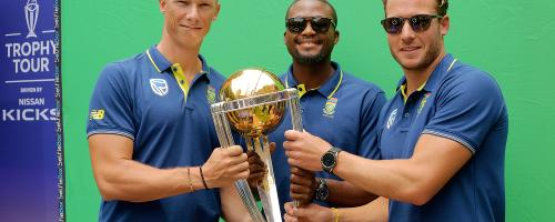 South Africa cricketers David Miller, Andile Phehlukwayo and Rassie van der Dussen pose with the CWC trophy