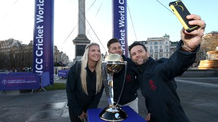 Harry Judd (right), Chris Hughes (centre) and Rebecca Adlington (left) pose with the ICC Cricket World Cup Trophy