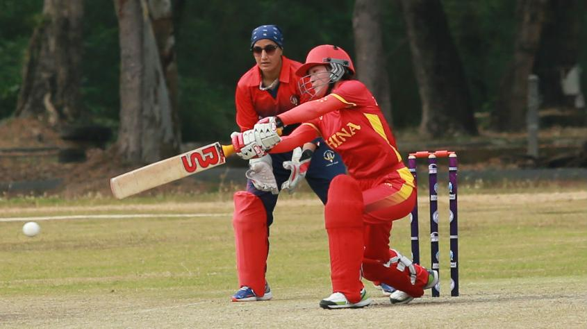 A China batter plays a shot